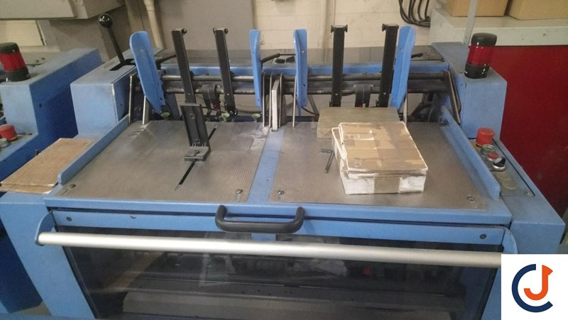 Müller Martini Presto E90 6 Station and cover feeder, gather, stitcher, trimmer